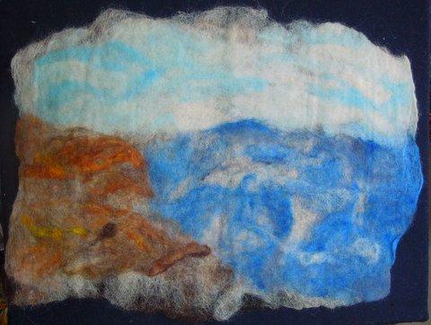 Elkins creates a background using wet felting