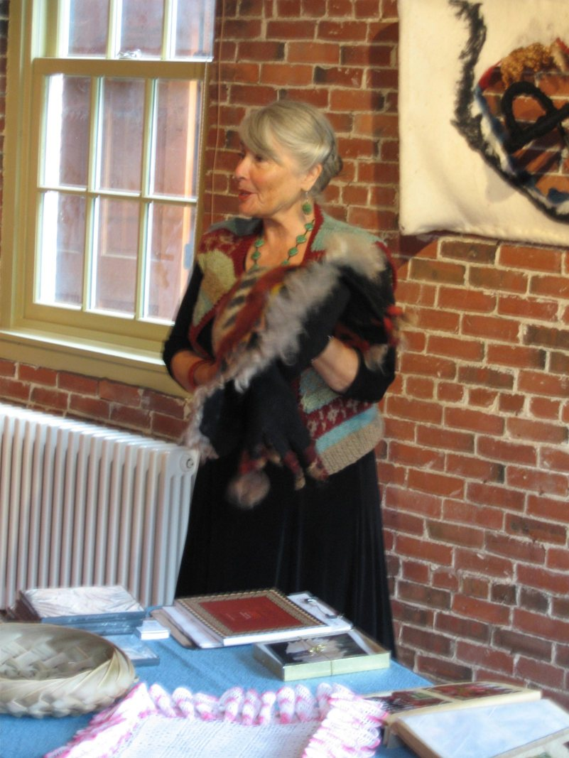 Susan reflects on her fiber art at a showing at the Maine Fiber Arts Gallery.